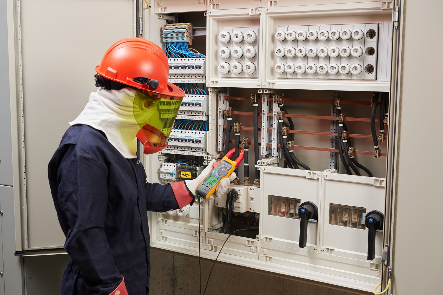 Fluke 378 FC Clamp Meter taking measurements in a panel.