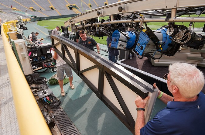 The stage used at the Green Bay game, called Eleanor by the crew, features a hydraulic roof