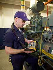 A technician reads data from the Fluke 810 Vibration Tester
