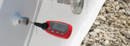 "An RTD is placed in a dry well calibrator and compared with a ""stik"" thermometer as a reference."