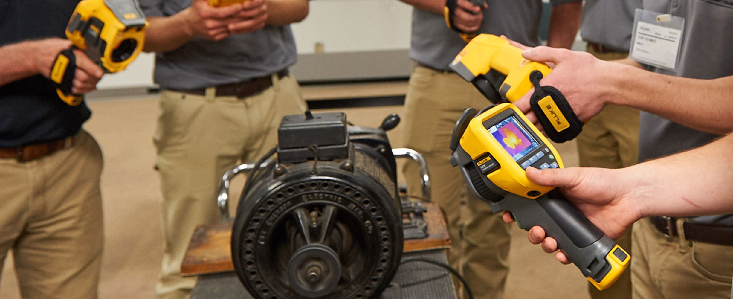 Students inspect a motor with Fluke infrared cameras during a training session