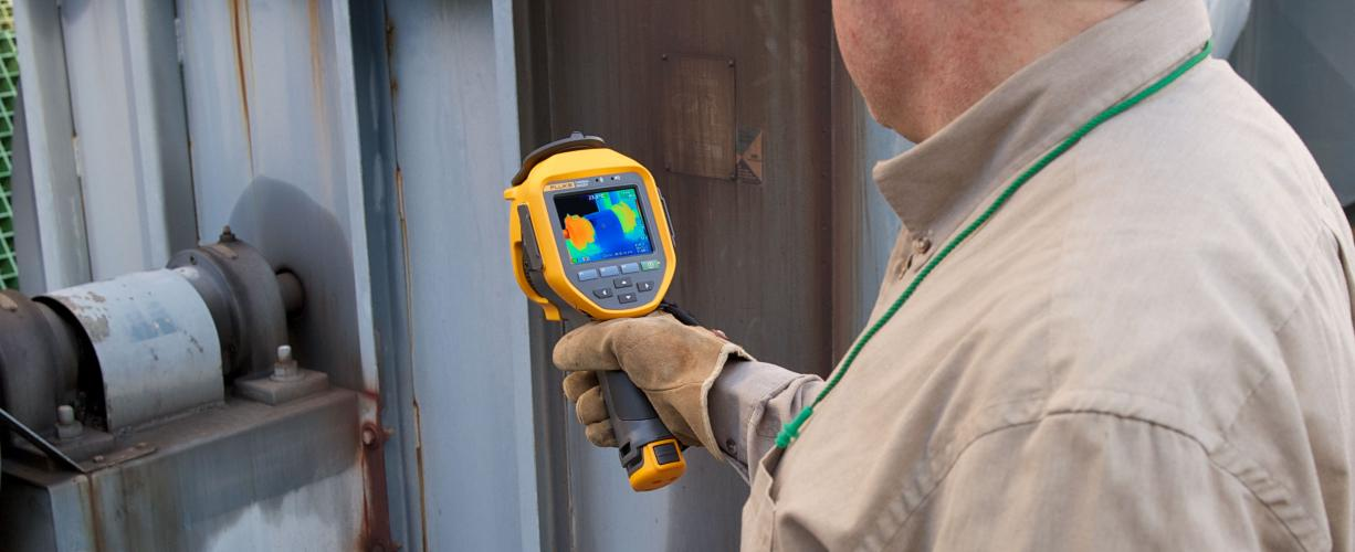 A thermal imaging expert examines equipment with a Fluke Infrared Camera