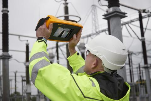 Electrician Detecting Electrical Partial Discharge at a Power Station with the Fluke ii910